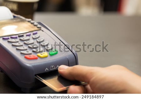 Credit Card Machind with Hand Swipe Credit Card Through Terminal For Sale In Store : Selective Focus - stock photo