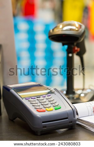 Credit Card Machine with Barcode Scanner in Background at the store - stock photo