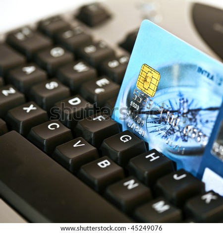 Credit card on a computer keyboard 04 - stock photo