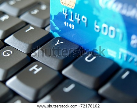 Credit card on computer keyboard. - stock photo
