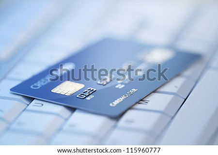 Credit Card on Computer Keyboard - 3d rendered with shallow DOF - stock photo