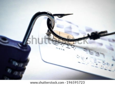 credit card with open security lock - risk of data theft using phishing method - stock photo