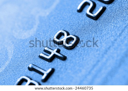 Credit card with shallow DOF. Close up of credit card, Only partial numbers are visible - stock photo