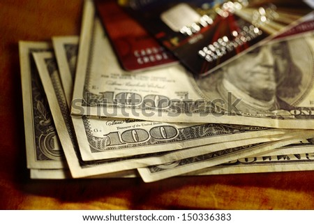 Credit cards and dollars in cash  - stock photo