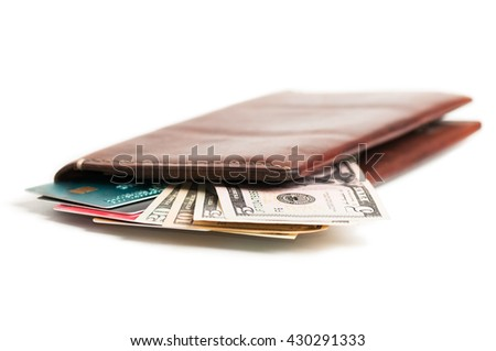 Credit cards and money in purse brown leather purse isolated on white background - stock photo