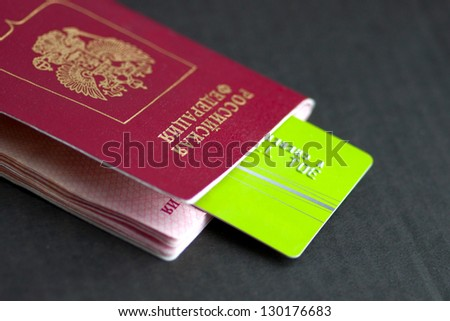 credit cards and passport on a dark background - stock photo