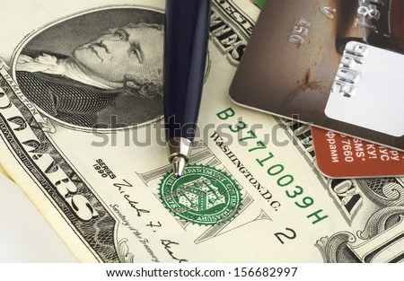 Credit cards, money and pen - stock photo