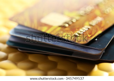 Credit cards on golden background - stock photo
