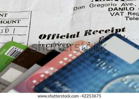 Credit cards soft image with Official receipt in focus. - stock photo