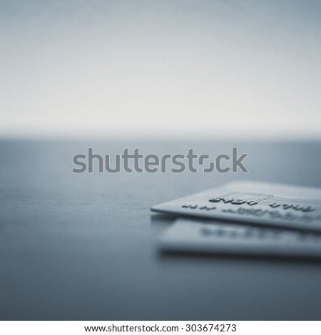 Credit cards up close on a desk - Split toned - stock photo