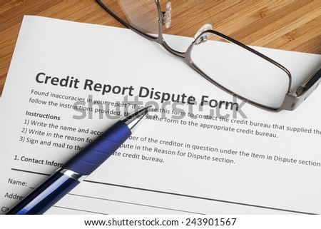 Credit report dispute score on a desk - stock photo