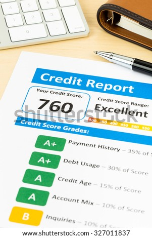 Credit score report with keyboard and pen - stock photo