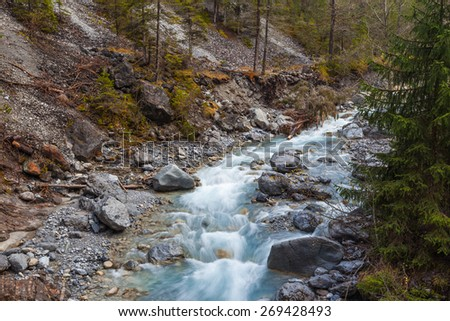 Creek in forest on the hiking path in Grisons, Switzerland - stock photo