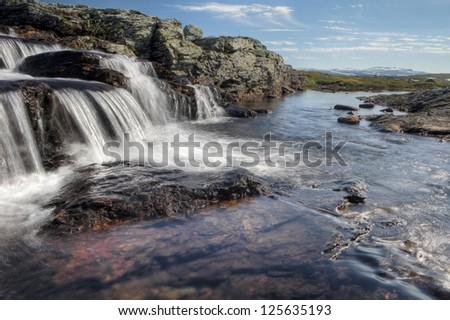 Creek in the Hardangervidda Nationlpark in Norway - stock photo