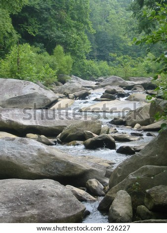 Creek with large rocks - stock photo