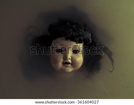Creepy doll face - stock photo