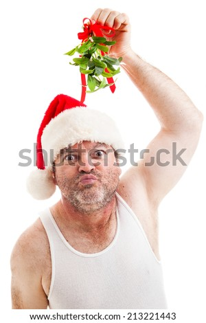 Creepy looking guy in his underwear holding up Christmas mistletoe and puckering up for a kiss.  Isolated on white.   - stock photo