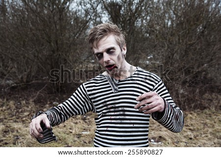 Creepy man with blood and zombie makeup - stock photo