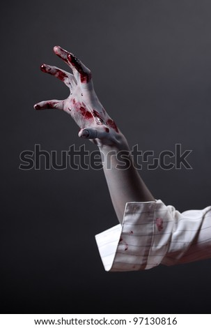 Creepy zombie hand, extreme body-art, studio shot - stock photo