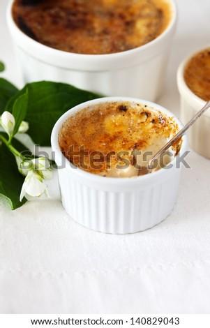 Creme in white ramekins - stock photo