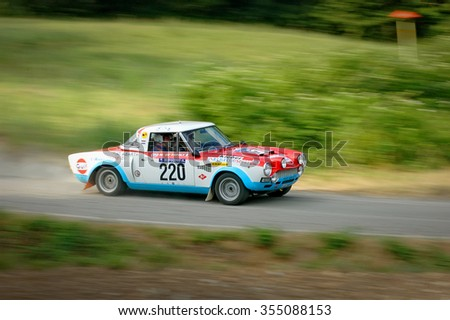 Cremona / Italy -  September 7, 2005 - Unidentified drivers on a white, blue and red vintage Fiat Abarth racing car - stock photo