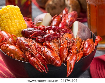 Creole style crawfish boil serving with corn and boiled potato - stock photo