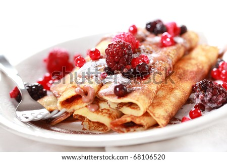 Crepes filled with chocolate and fruits - stock photo