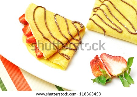 crepes with fruit and chocolate - stock photo