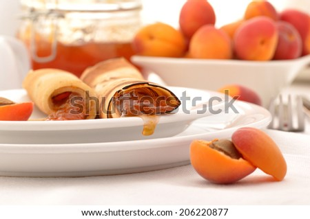 Crepes with homemade apricot jam - stock photo