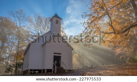 Crepuscular Rays Fall Upon Cades Cove Missionary Baptist Church - stock photo