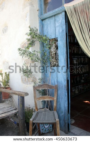 Crete, Blue door and old chair, Greece - stock photo