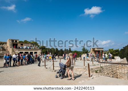 CRETE, GREECE - OCTOBER 09: unidentified tourists visiting Knossos Palace on October 09, 2014 in Crete, Greece. The Minoan Palace is the largest Bronze Age archaeological site on Crete. - stock photo
