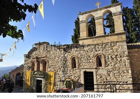 Crete, Greece, - September. 7. 2008: Greek Orthodox ceremony at Monastery of Panagia Kardiotissa, old monastery situated near Lasithi Plateau, the heart of Crete Island, Greece  - stock photo