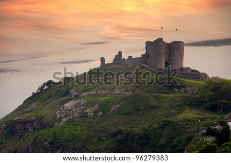 Criccieth Castle at sunset. Medieval castle on the Llyn peninsula, North Wales, UK - stock photo
