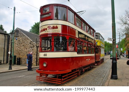 CRICH, ENGLAND - JUNE 5. The National Tramway Museum features historic tramcars from Leeds and Blackpool on June 5, 2014, Crich, England. - stock photo