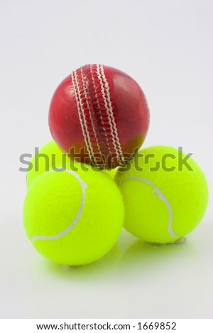 Cricket and tennis balls stacked - stock photo