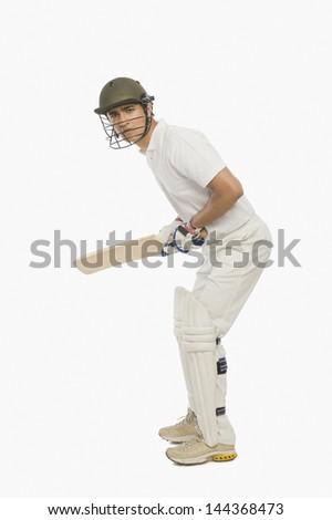 Cricket batsman playing a defensive stroke - stock photo