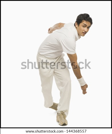 Cricket bowler in action - stock photo