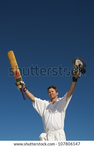 Cricketer celebrates 100  runs - stock photo