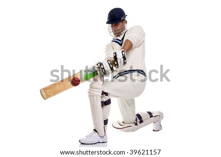 Cricketer down on his knee playing a shot, studio shot on white background. - stock photo