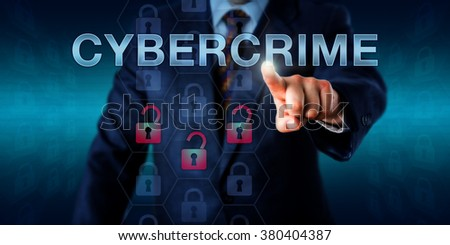 Crime investigator pushing CYBERCRIME onscreen. Business metaphor and technology concept. Three red unlocked padlock icons do represent a security breach, hacking attempt or compromised information.  - stock photo