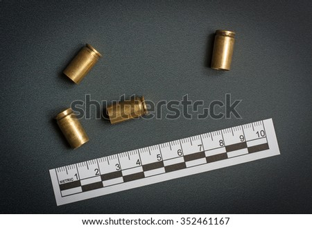 Crime scene, empty bullets casings on ground - stock photo