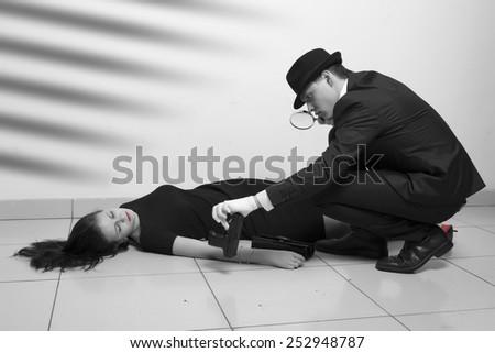 Crime scene imitation. Detective investigating the crime scene - stock photo