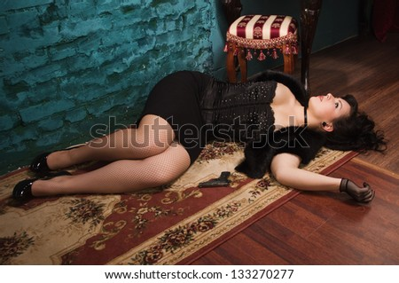 Crime scene in a vintage style. Victim lying on the floor - stock photo