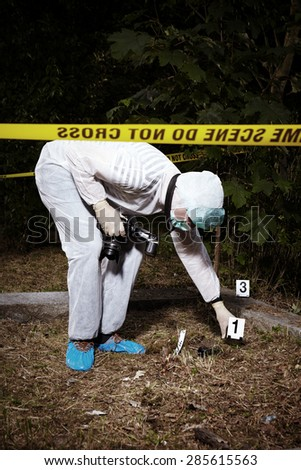 Crime scene investigation - collecting of evidence on place of crime - stock photo