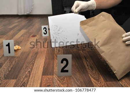 Crime scene- revealing and preserving criminological tracks - stock photo
