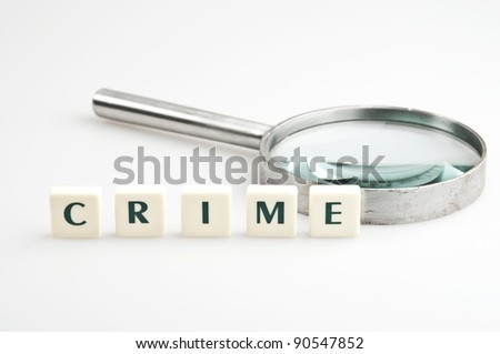 Crime word and magnifying glass - stock photo