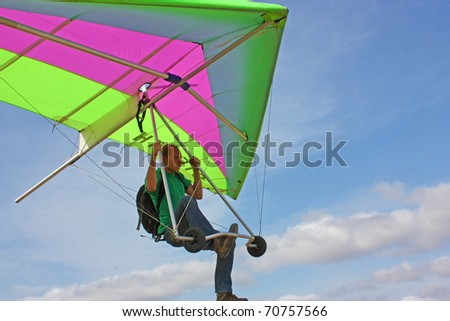 CRIMEA, UKRAINE - SEPTEMBER 9: Competitor of the Grininko hang gliding competitions on the Klementieva mountain on September 9, 2010 in Crimea, Ukraine - stock photo