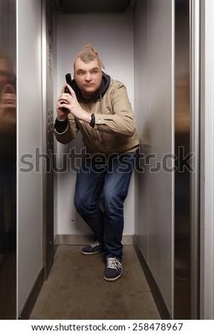 Criminal in stocking attacking - stock photo