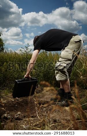 Criminal man hiding contraband - stock photo